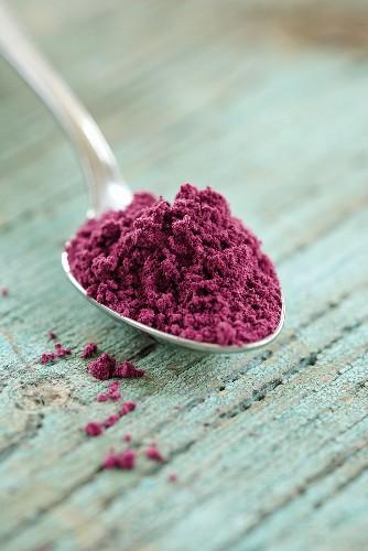 Acai powder (diet aid) on spoon