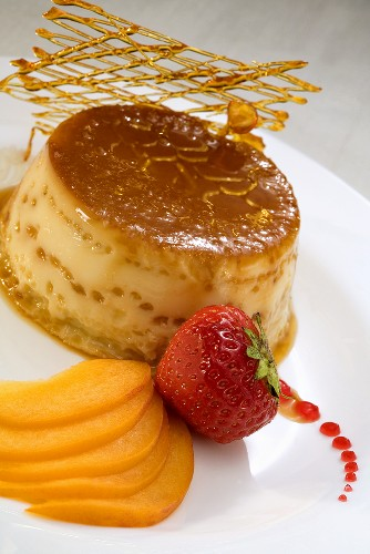 Crème caramel with peaches and caramel lattice