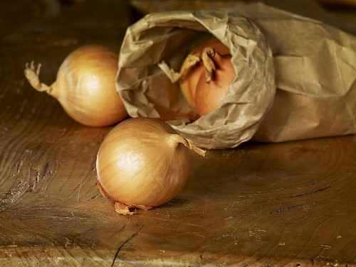 Yellow onions with paper bag