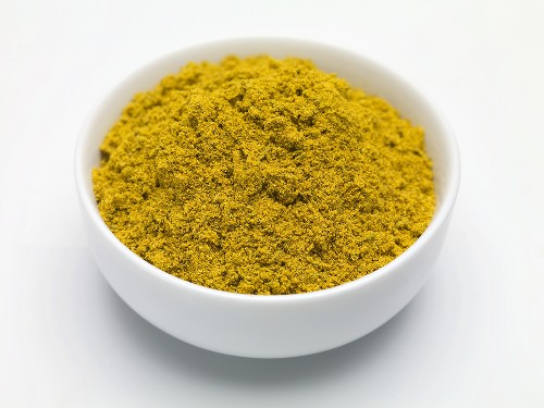 Seasoning mixture (Colombo Powder) in a small bowl