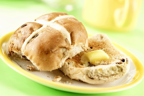Toasted hot cross bun with a knob of melting butter