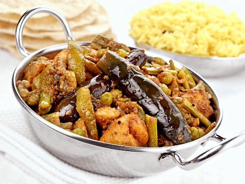 Undhiyu (Indian vegetable dish) with rice and flatbread