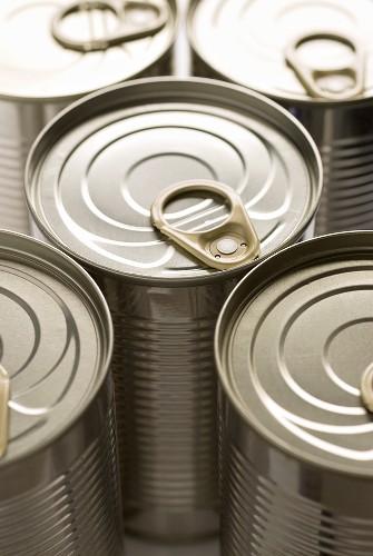 Five unopened food tins
