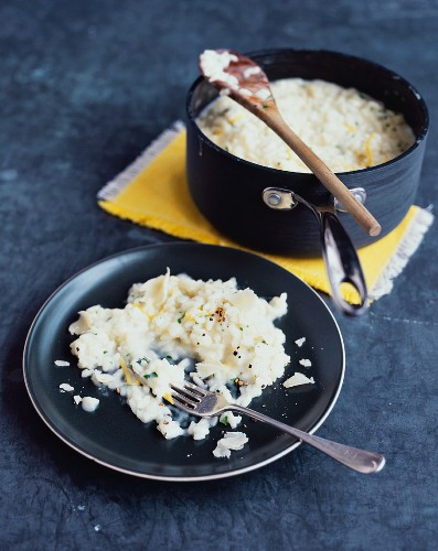 Parsley and lemon risotto on a plate and in a pan