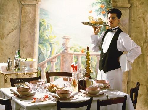 Waiter is serving Aperitif