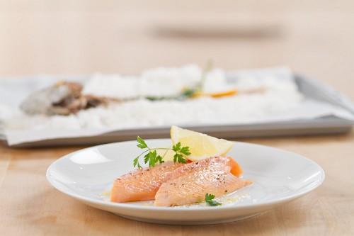 Salmon trout in salt crust