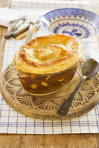 A beef and kidney bean pie in a pie dish