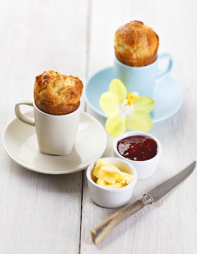 Popovers (American breakfast pastries) with butter and jam