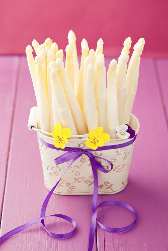 White asparagus in an old metal basket