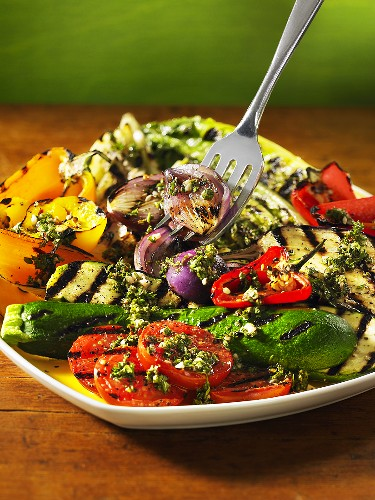 A grilled vegetable platter with herb sauce