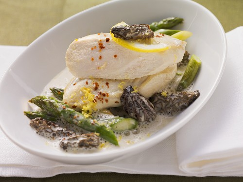 Poached chicken breast with asparagus and morel mushrooms with lemon sauce