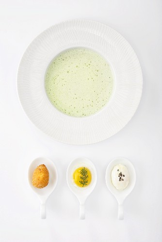 Cold cucumber soup with a trio of quail's eggs