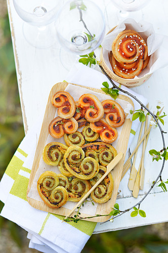 Two different pesto Palmiers for an aperitif outdoors