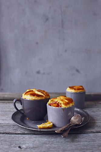 Young carrot and country sausage mini mug pies