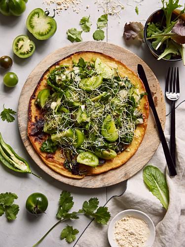 Chickpea flour pizza garnished with salsa verde