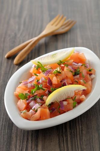Tomato,red onion,chopped parsley and lemon salad