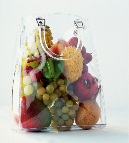 tropical fruit in transparent shopping bag