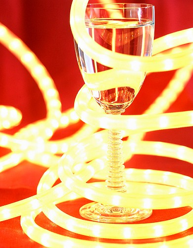A glass of water with a light rope