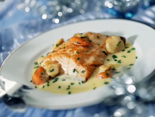 Roast salmon fillet with flambeed scallops and cognac sauce
