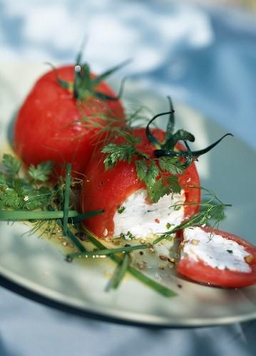 Peeled tomatoes stuffed with fresh goat's cheese