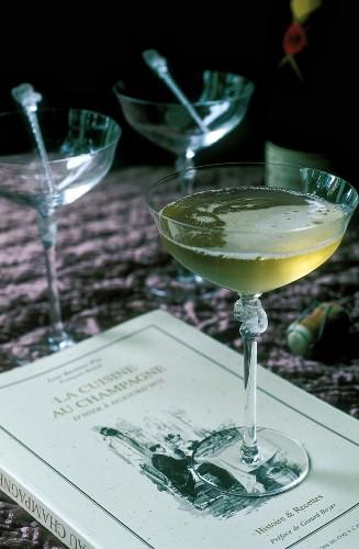 A glass of champagne on a champagne recipe cookbook
