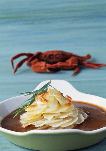 Potato millefeuille in a crab sauce with Java pepper
