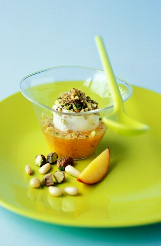 Petit-suisse with peach coulis and dried fruit
