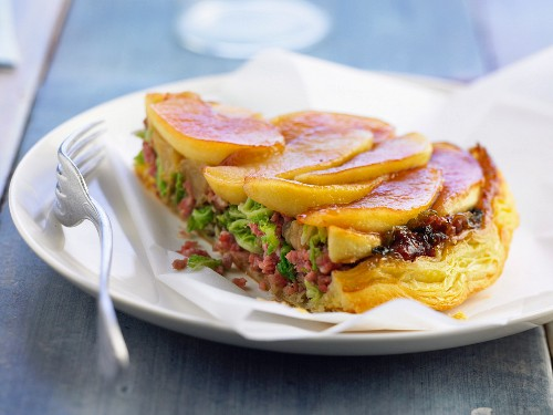 Upside down apple cake with minced sausages and cabbage