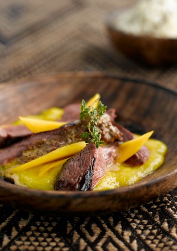 Wild duck with mango and mustard sauce