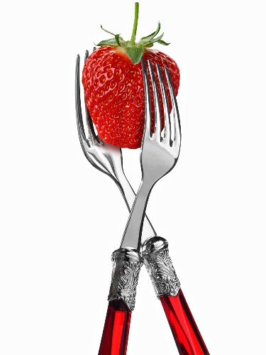 Two forks with strawberry