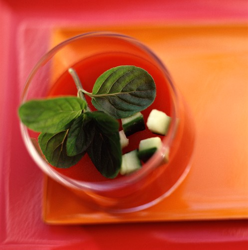Cream of tomato soup with basil and raw, diced courgette