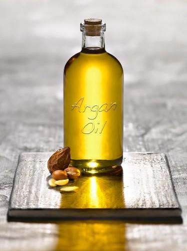 Bottle of argan oil and argan nuts