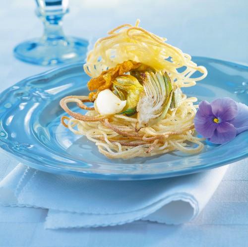 Crunchy spaghetti nest with zucchini flowers