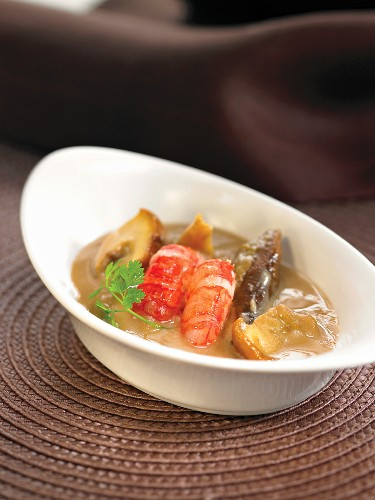 Boletus mushroom and gambas stew in creamy Brandy sauce