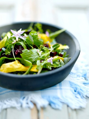 Crisp vegetable and edible flower salad