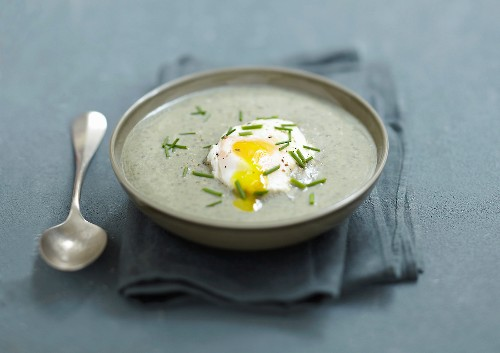 Cream of green lentil soup with a soft-boiled egg