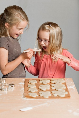 Young girls making cookies