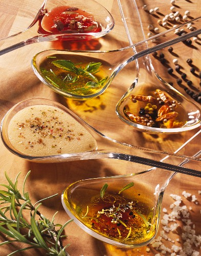 Spoonsful of different types of sauces and vinaigrettes