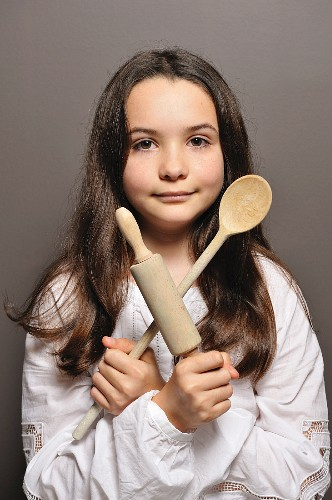 Young girl with cooking implements