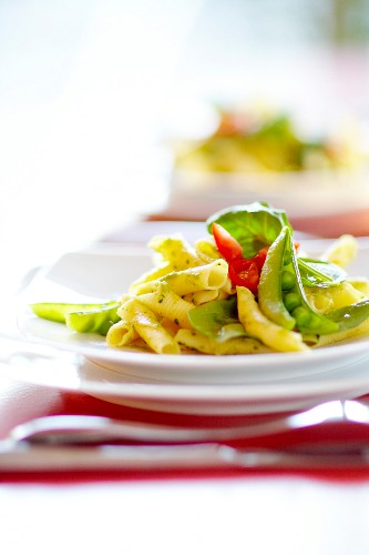 Pasta with peas,basil,tomatoes and pesto