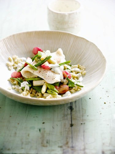 Steamed cod fillet with wheat and vegetables