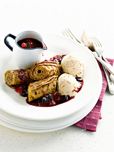 Rolled pancakes with stewed summer fruit and nougat ice cream