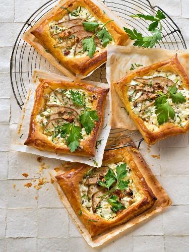 Fresh goat's cheese,pear,hazelnut,honey and flat parsley small tarts