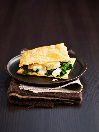 Fish and spinach flaky pastry dish