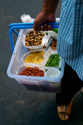 Person selling dried vegetables in the street