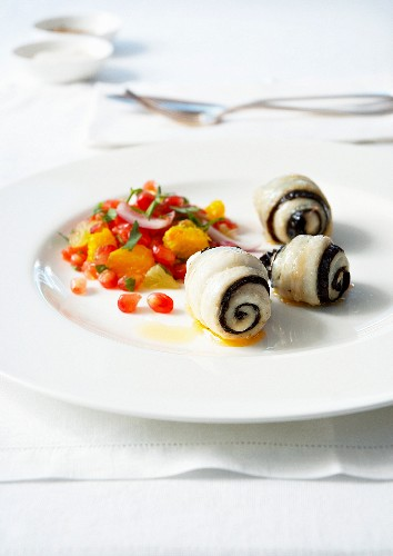 Rolled dab fillets and seaweed, citrus fruit and pomegranate seed salad