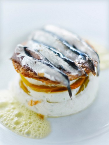 Cream cheese,marinated pepper,chestnut flour crisps and fresh anchovy starter