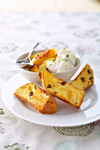 Grilled raisin brioche,poached peaches and mascarpone mousse sprinkled with crushed pistachios