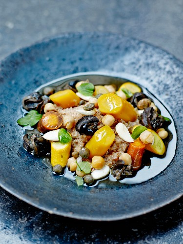 Spelt couscous with snails, yellow zucchinis and two types of carrots