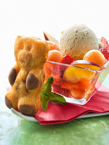 Summer fruit salad,bear cookie and a scoop of vanilla ice cream